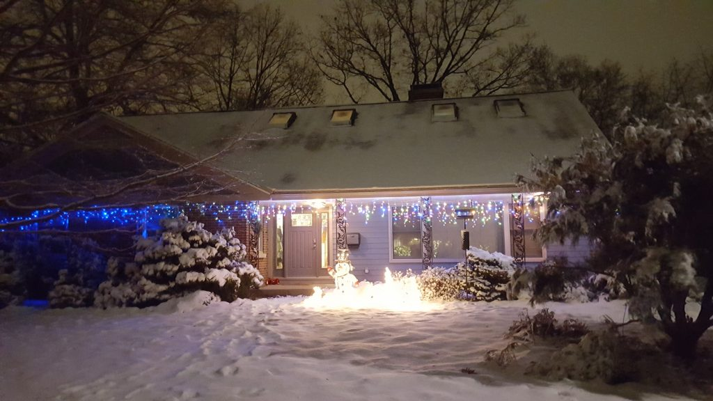 My parent's house at night with lots of Christmas lights