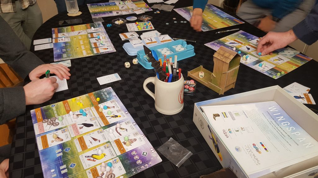 A table with the boardgame Wingspan laid out. Lots of bird cards